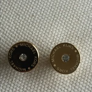 Michael Kors gold disc studs with cubic zirconia.